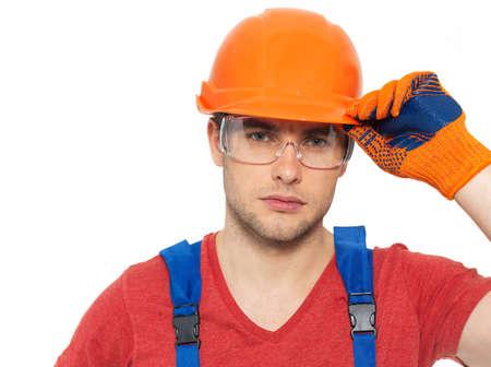Closeup portrait of thinking handyman in uniform isolated on  white background photo