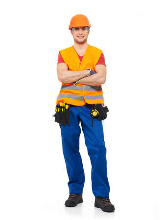 Smiling workman with tools in orange uniform full portrait over white background