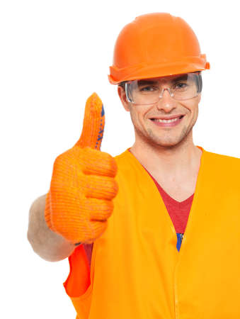Closeup portrait of smiling craftsman thumbs up sign  in orange protective uniform  isolated on  white background photo