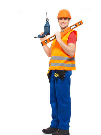 Smiling workman with tools in orange uniform full portrait over white background photo