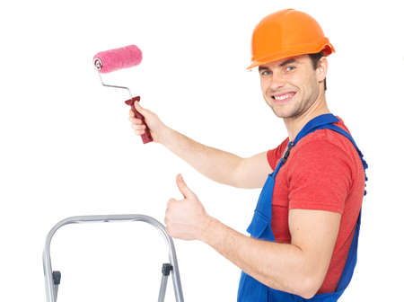 Craftsman painter stands on the stairs with roller and showing the thumbs up sign, full portrait over white background photo