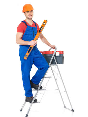 Craftsman with tools  with stairs , full portrait over white background photo