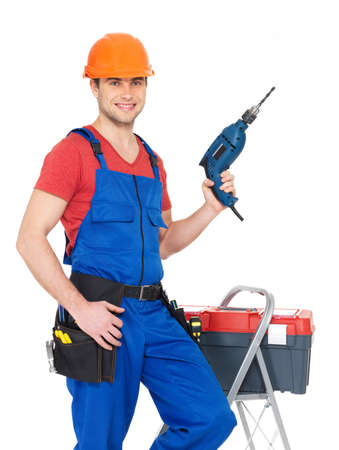 Portrait of smiling manual worker with tools isolated on  white background photo