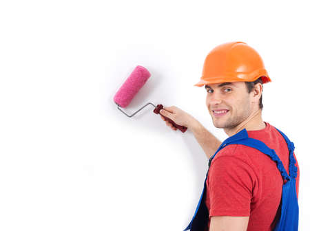 Craftsman painter stands on the stairs with roller, full portrait over white background photo
