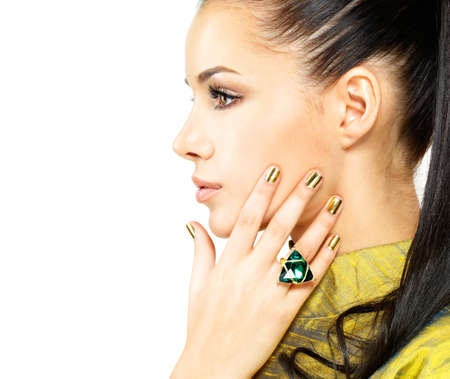 emerald stone: Pretty woman with golden nails and beautiful precious stone emerald - isolated on white background Stock Photo