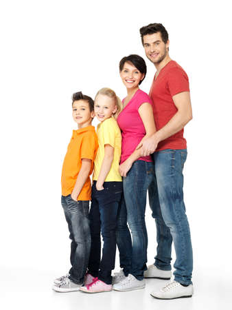 standing in line: Full portrait of happy young family with two children standing together in line - isolated on white background Stock Photo