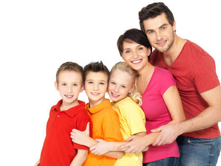 girl bonding: Happy young family with two children standing together in line - isolated on white background