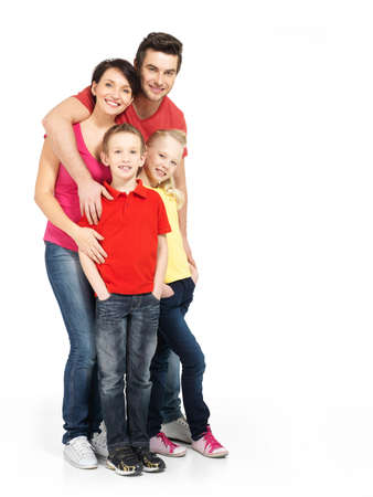 family fun: Full portrait of the happy young family with two children isolated on white background
