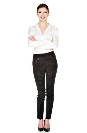 Full portrait of young  beautiful woman  in white shirt and black trousers  standing isolated on white background.   photo