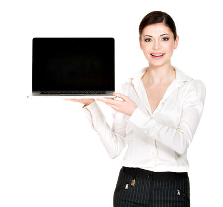 Portrait of smiling happy woman holds laptop on palm with blank screen - isolated on white. Concept communication.