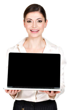 Portrait of smiling happy woman holds laptop on palm with blank screen - isolated on white. Concept communication.  photo
