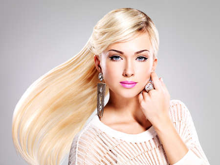 Beautiful woman with long white hairs and bright fashion makeup.  photo