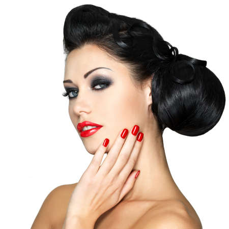 Beautiful fashion woman with red lips, nails and creative hairstyle - isolated on white background Stock Photo - 18856255