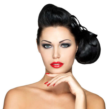 Beautiful fashion woman with red lips, nails and creative hairstyle - isolated on white background photo