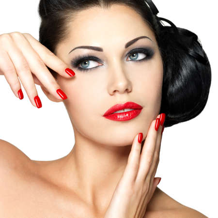 red nails: Beautiful young woman with red nails and fashion makeup - isolated on white background Stock Photo