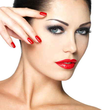 Beautiful young woman with red nails and fashion makeup - isolated on white background Stock Photo