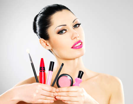 Beautiful woman with makeup cosmetic tools near her face. Stock Photo - 18856265