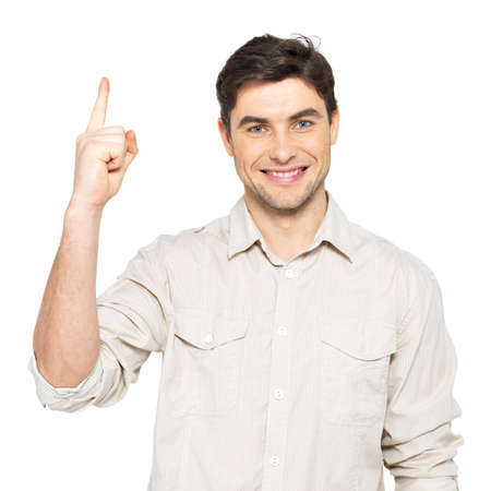 Young happy man with good idea sign  in casuals isolated on white background. Stock Photo - 19062557
