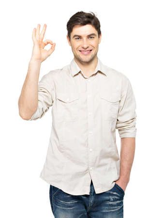 ok hand: Young happy man with ok sign in  casuals isolated on white background.