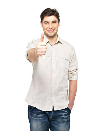 Young happy man with thumbs up sign in  casuals isolated on white background. photo