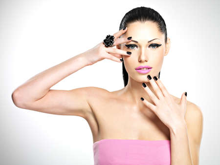 Face of the  beautiful sexy  woman with black nails and pink lips. Sexy girl with fashion makeup Stock Photo - 19270914
