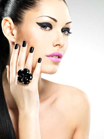 Face of the  beautiful sexy  woman with black nails and pink lips. Sexy girl with fashion makeup Stock Photo - 19270916