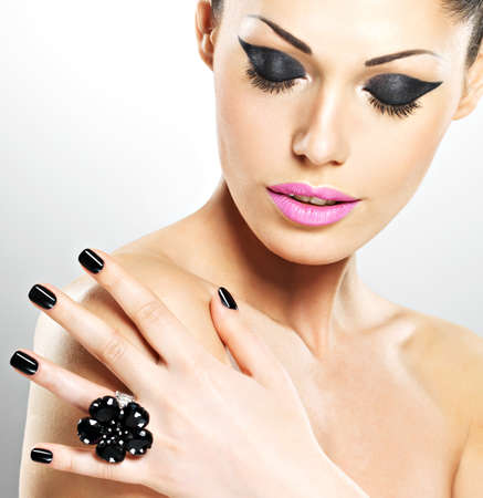 Face of the  beautiful sexy  woman with black nails and pink lips. Sexy girl with fashion makeup Stock Photo - 19271063