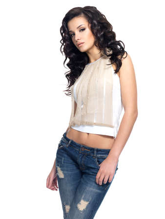 Full portrait of fashion model with long hair dressed in blue jeans photo