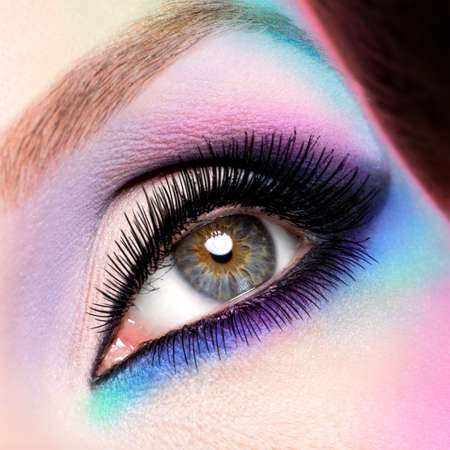 Closeup woman eyes with beautiful  fashion bright blue makeup photo