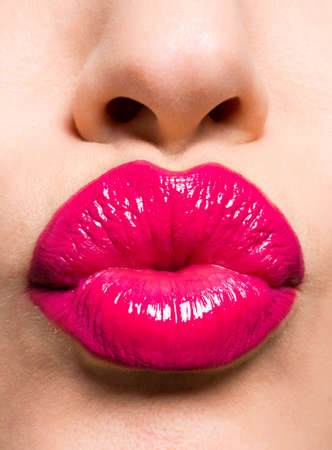 red lips: Closeup image of a  beautiful sexy red lips giving kiss Stock Photo