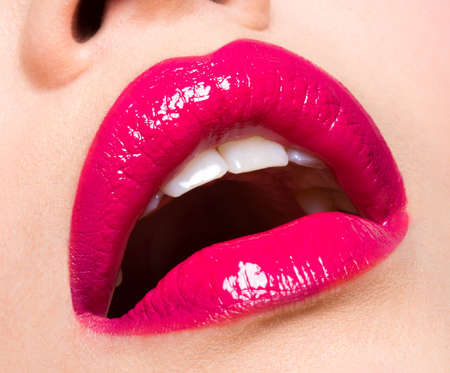 open lips: Closeup photo of a  beautiful sexy red lips Stock Photo