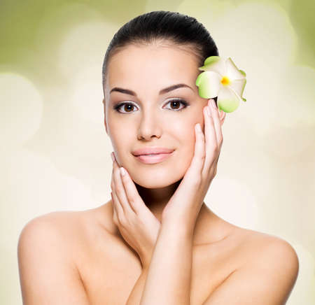 health care concept: Beautiful young woman with healthy skin face. Skin care concept. Stock Photo