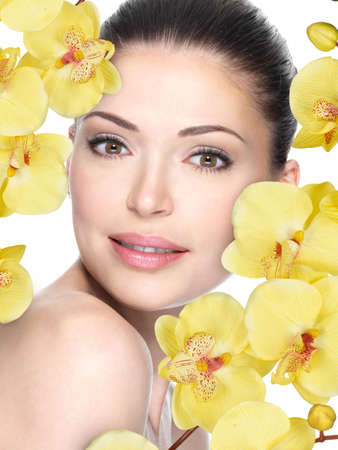 Adult woman with beautiful face and yellow flaowers - isolated on white. Skin care concept. Stock Photo