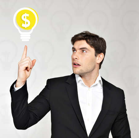 Young handsome businessman with lamp, idea concept Stock Photo - 19339857