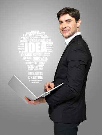 Profile portrait of smiling businessman with laptop and lamp. Concept idea  communication.