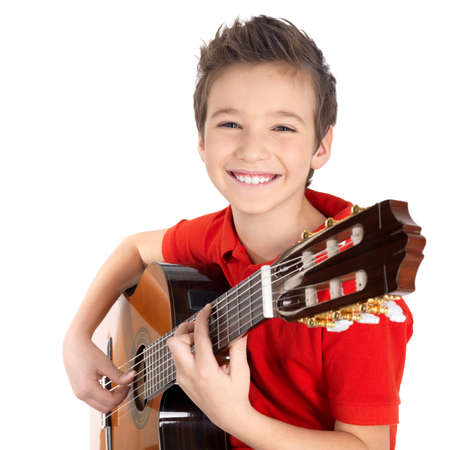 Happy boy is playing on acoustic guitar - isolated on white background Stock Photo