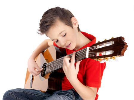 White boy is playing on acoustic guitar - isolated on white background