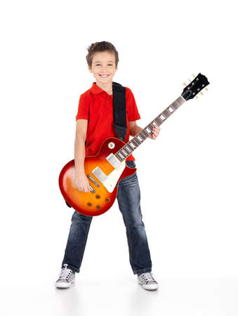 musician: Portrait of young boy with a electric guitar - isolated on white background