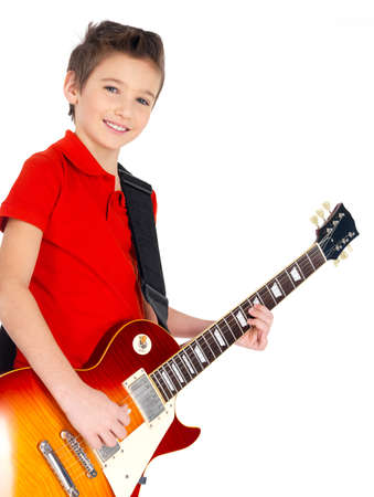Portrait of young smiling boy with a electric guitar - isolated on white background photo