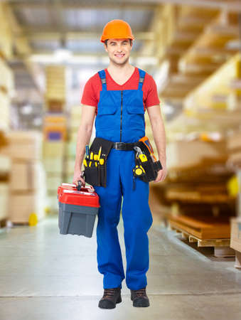 Handyman with tools full standing in shop Stock Photo - 20364842