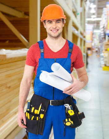 Portrait of smiling handyman with tools and paper  photo