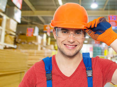 Portrait of the smiling  professional handyman at store photo