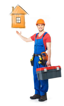 Handyman with tools full portrait with house sketch  photo