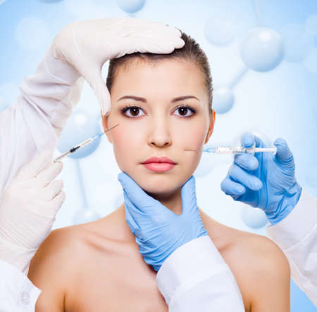 to inject:  Injection of botox in beautiful woman face over molecule background