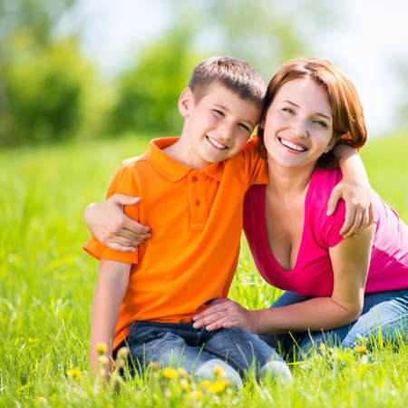 mama: Happy mother and son in the spring meadow outdoor portrait Stock Photo