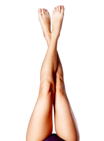 thigh: Beautiful long slender female legs after depilation. Photo  on grey background Stock Photo
