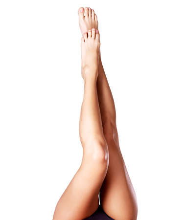 young woman legs up: Beautiful female legs after depilation. Photo  on grey background