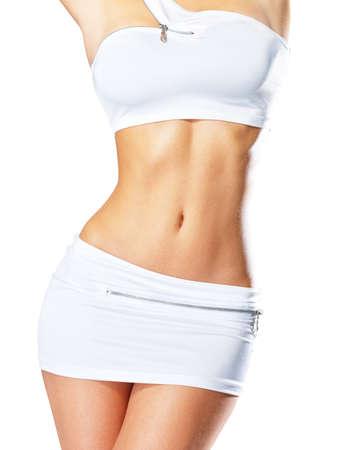Beautiful sexy female slim tanned body - a studio shot Stock Photo