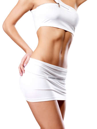 body curve: Beautiful healthy female body in white sport clothes