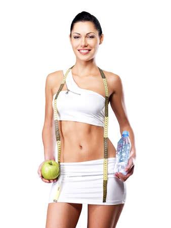 cuerpo femenino perfecto: Estilo de vida saludable de una mujer feliz con el cuerpo delgado despu?s de la dieta. Hembra deportiva con cuerpo perfecto Foto de archivo